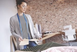 Photography of tailor designing clothes